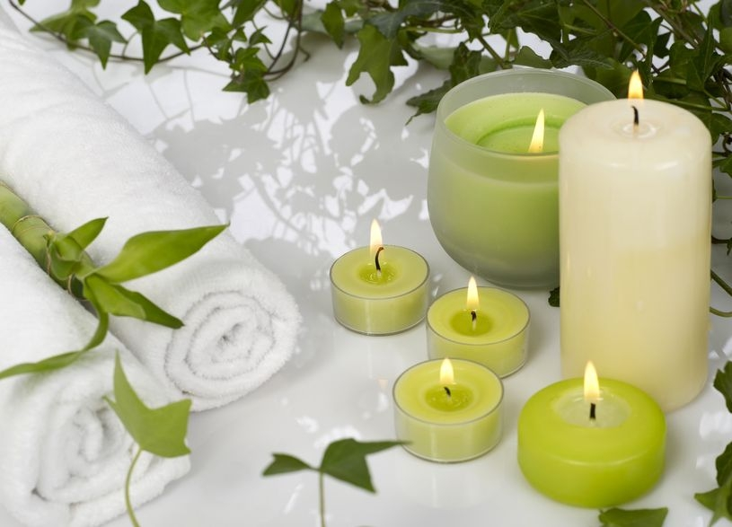 beautiful selection of green candles with flames