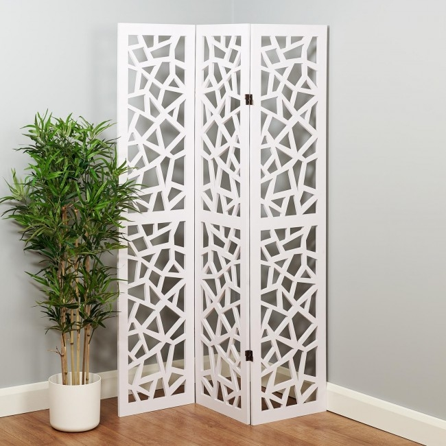 3 panel white cut out room divider making a living room feel more homely