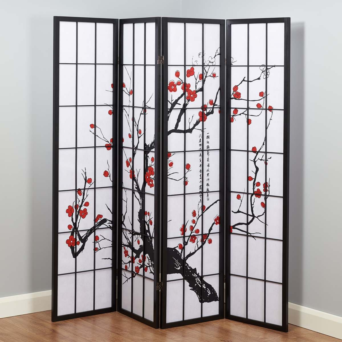 hartleys four panel japanese style cherry blossom design room divider stood in a living room for decoration