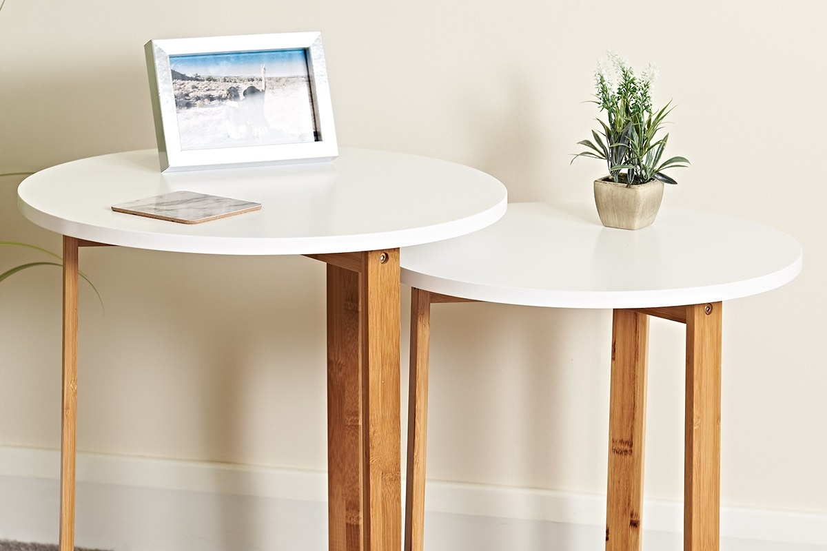 stunning white and bamboo nest of tables