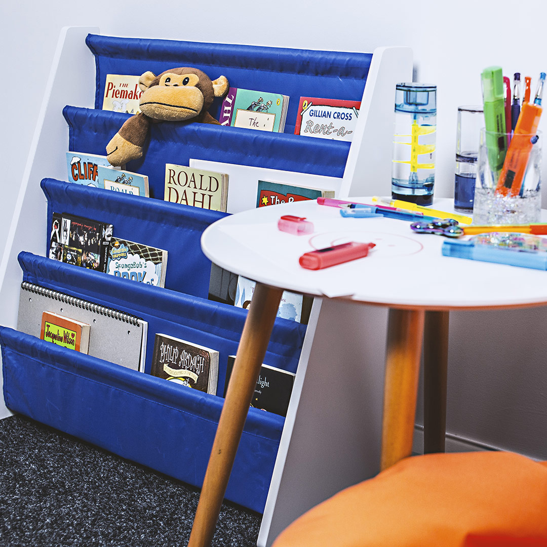 hartleys-benefits-of-reading-blog-image-of-hartleys-blue-childrens-bookshelf-in-bedroom-setting-with-books-and-toys
