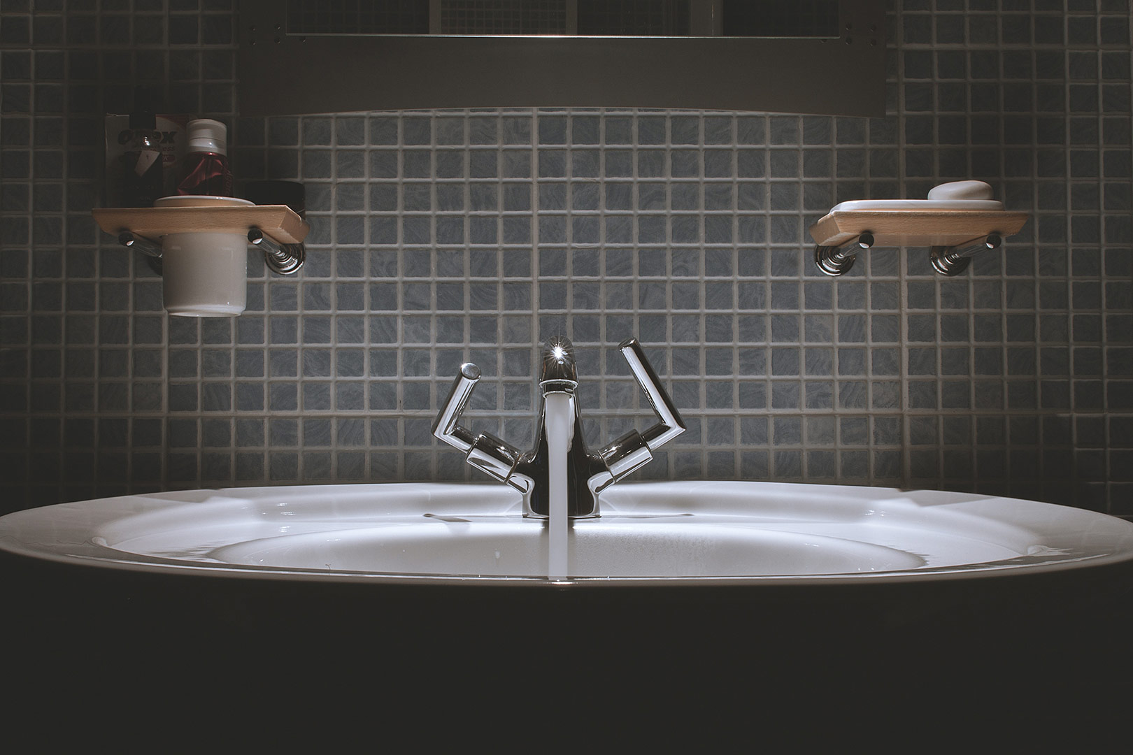 hartleys-blog-clever-ideas-for-small-bathrooms-blog-picture-of-a-bathroom-basin-and-some-shelving