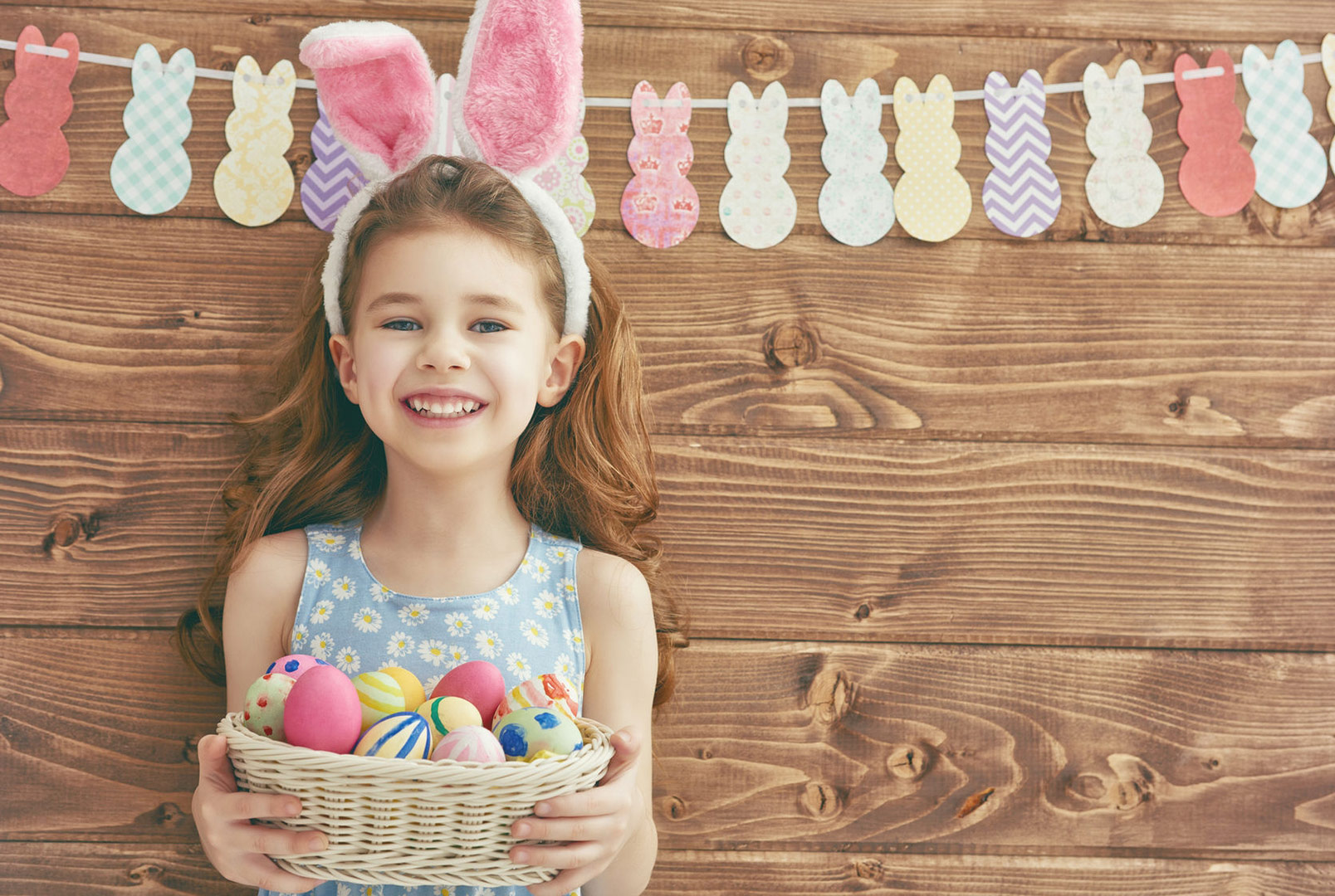 Hartleys-blog-on-easter-egg-hunt-ideas-picture-of-girl-holding-a-basket-of-eggs