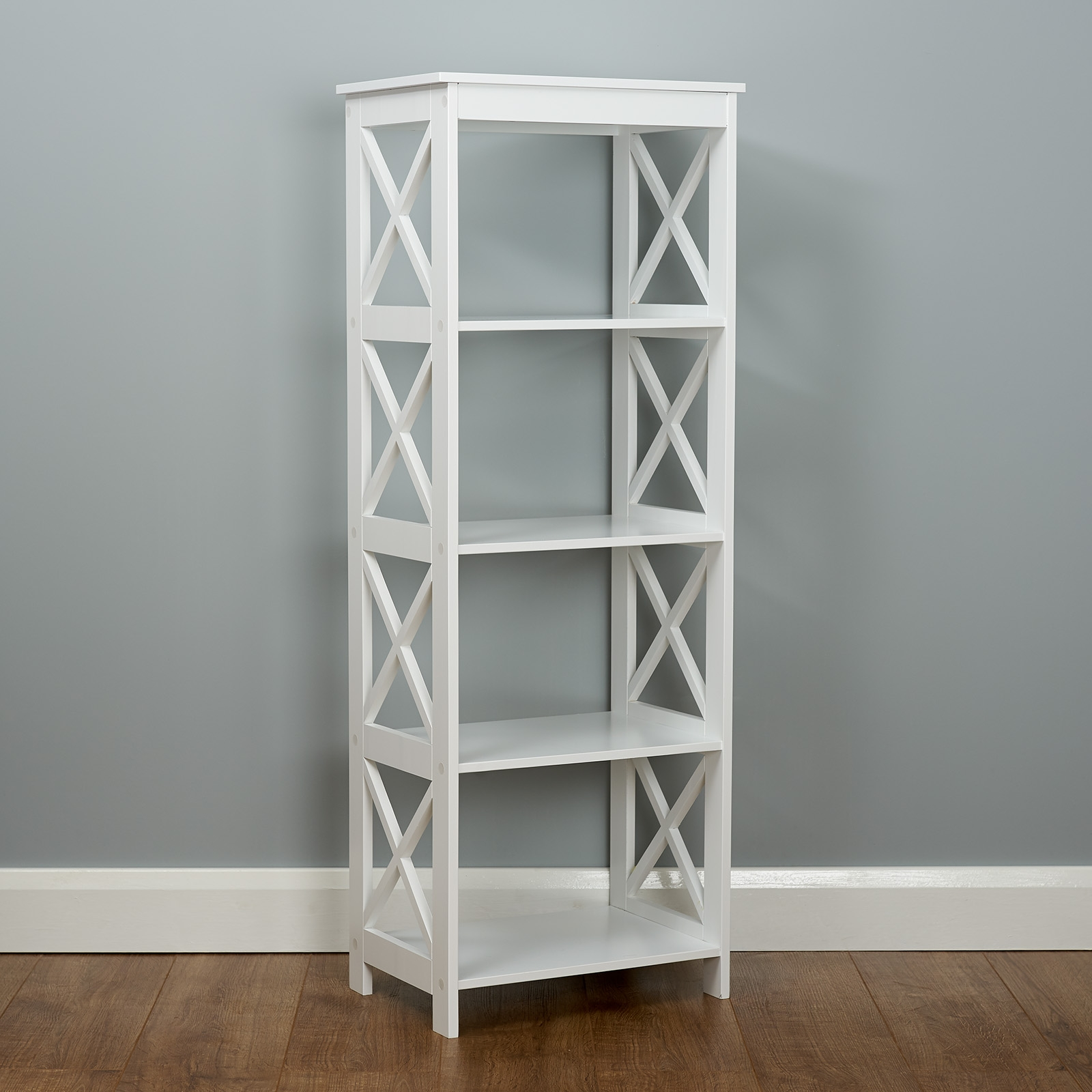 modern white cross cut out bookcase standing in a grey painted room with wooden flooring