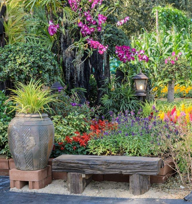 Image of garden bench in a pretty garden