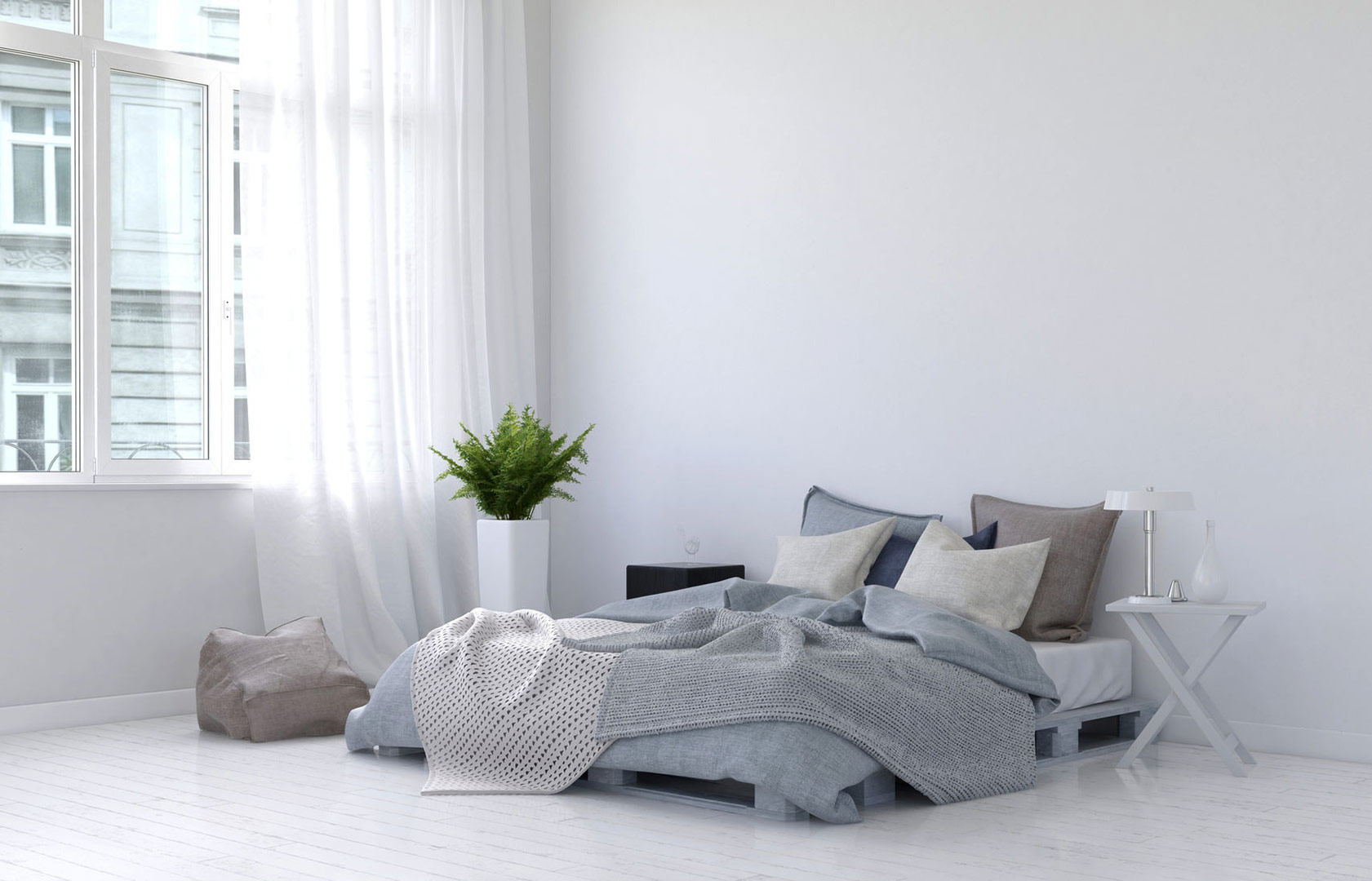 stunning white bedroom with a bed and very minimal accessories or furniture