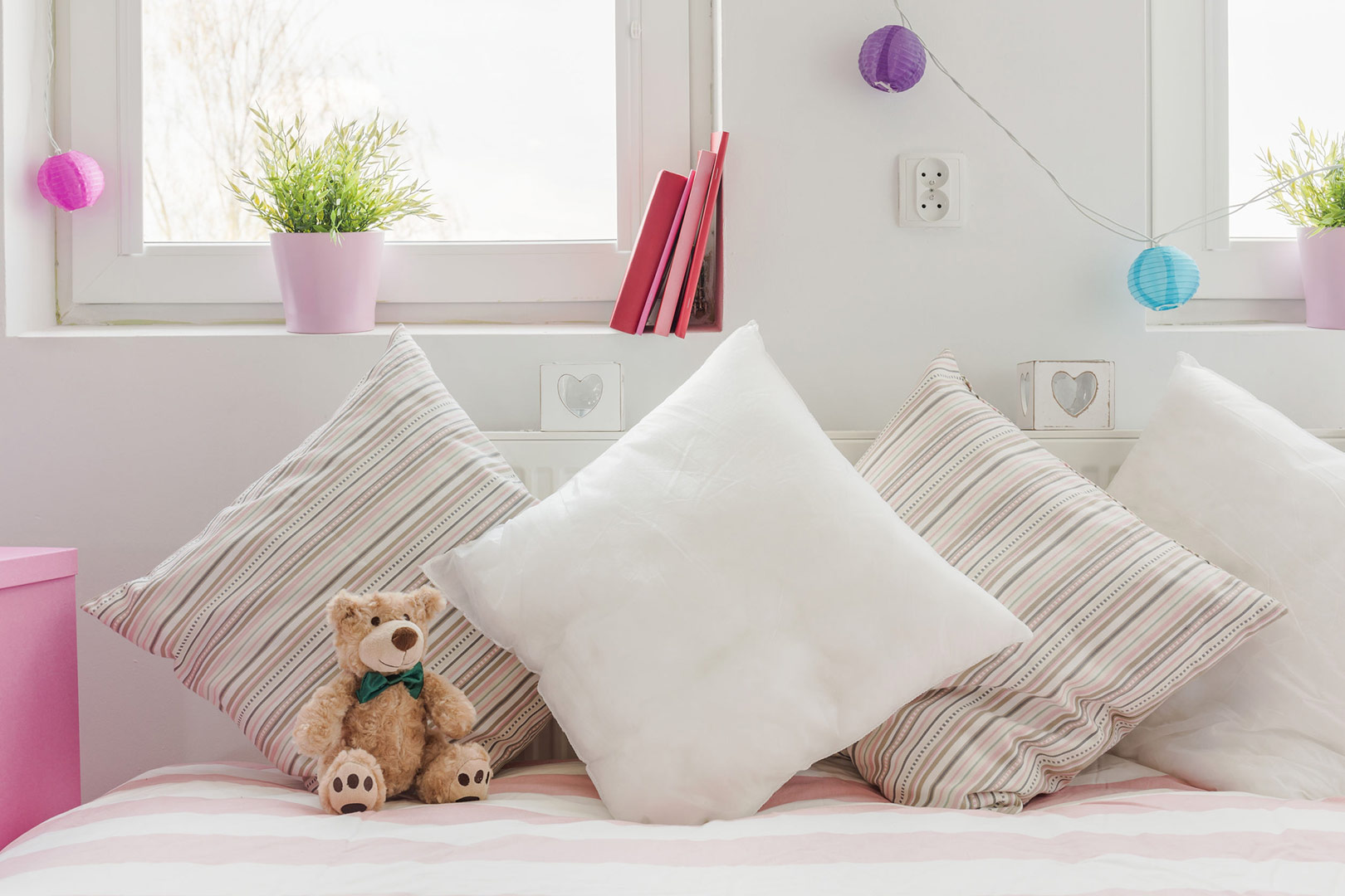 stunning white baby bedroom with cute cushions and accessories