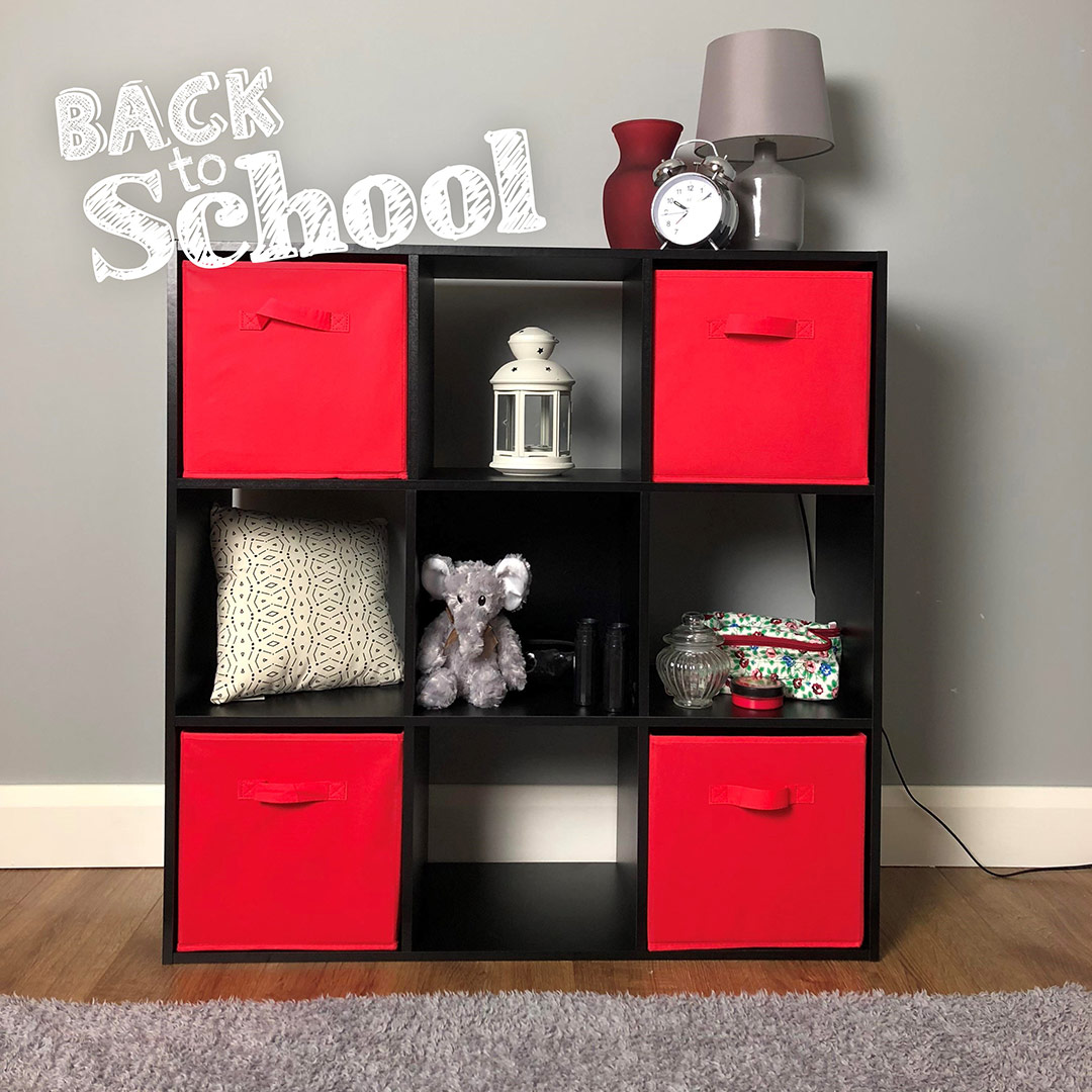 9 black cube storage with red boxes in a kids bedroom