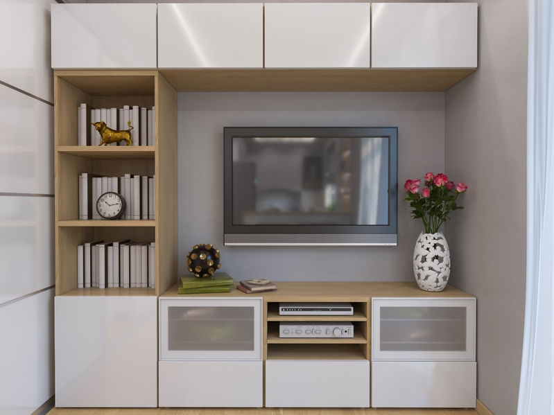 lots of wall storage and cupboards in a neutral colour
