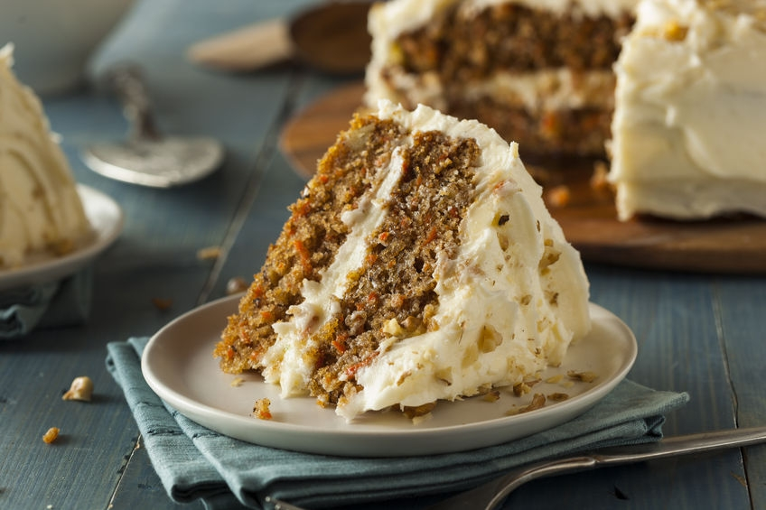 delicious carrot cake on a plate with yummy cream cheese topping