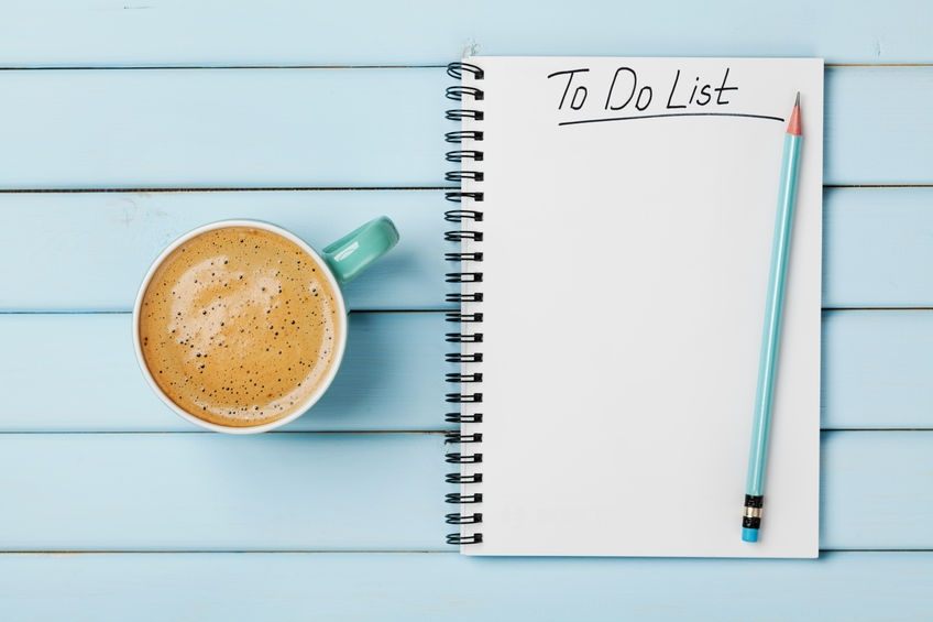 a checklist for the day with a pen and notepad