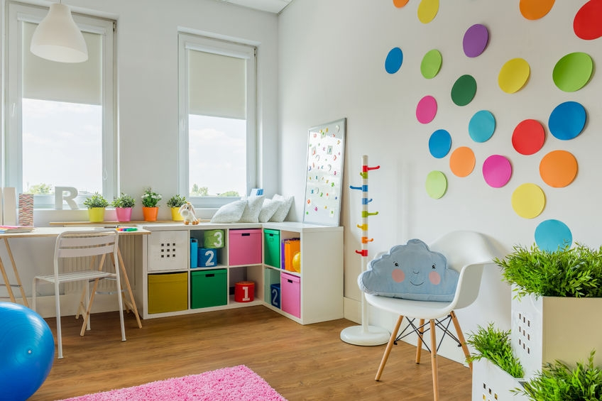 brightly coloured children's bedroom with play area and bed