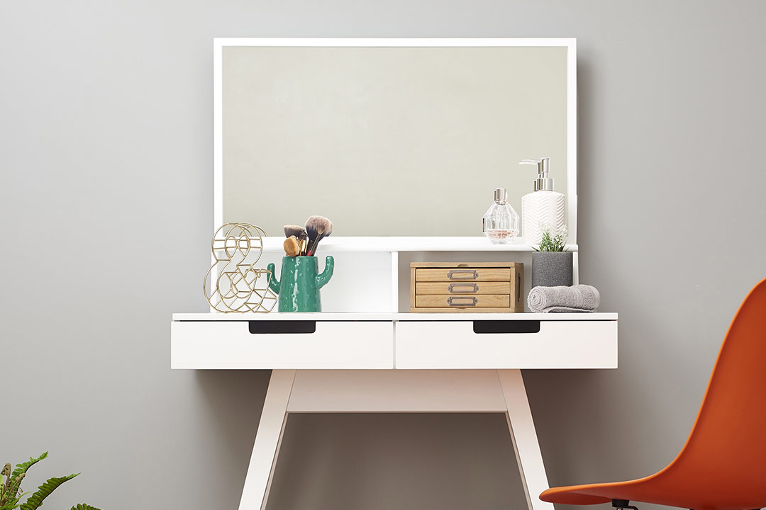 modern white dressing table with a minimalistic style in a bedroom