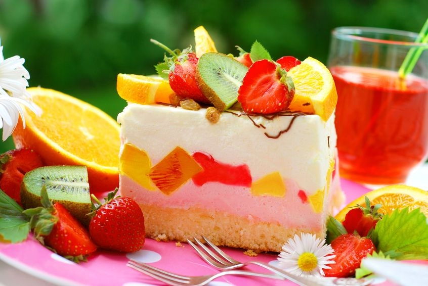 image of a slice of sweet cake with fruit in a garden
