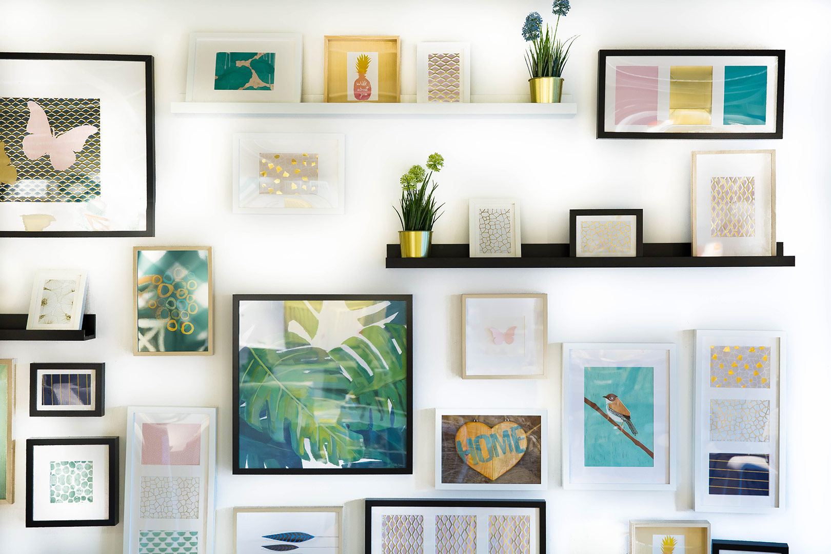 neatly arranged photo frames mounted to a wall