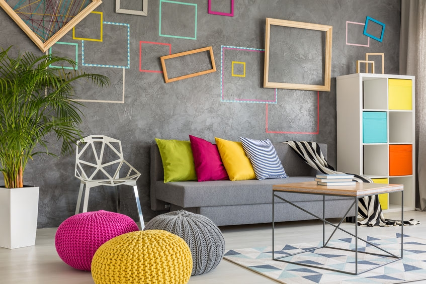 super vibrant and colourful living room with lots of pink yellow and blue accessories