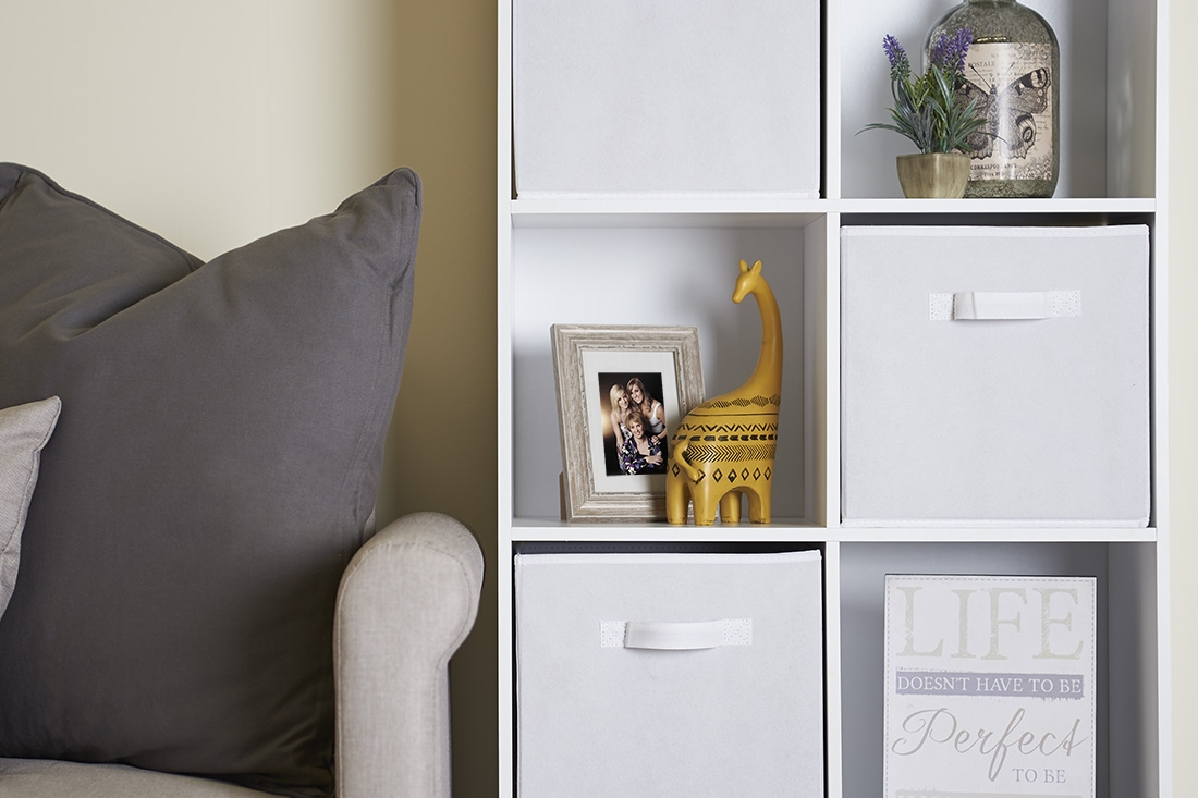 stunning 8 tier cube storage in white in a living room with accessories and a sofa