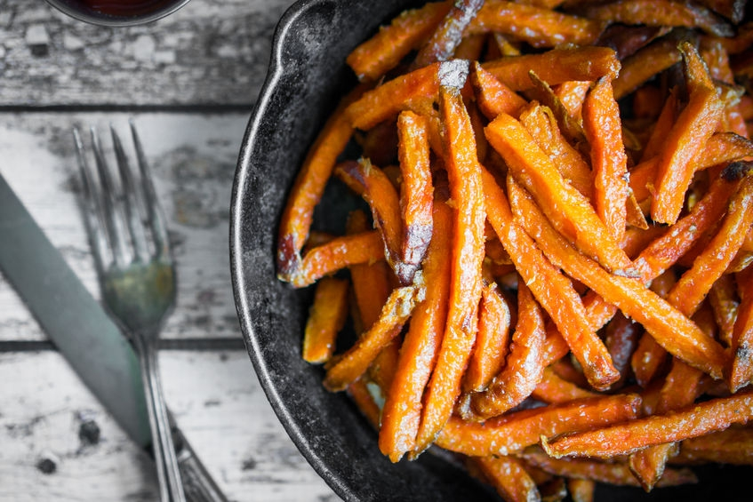 delicious sweet potato fries on a plate with a knife and fork
