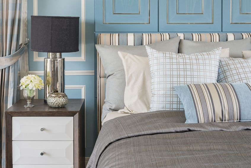 cute personalised bedroom with blue decorate bedside table