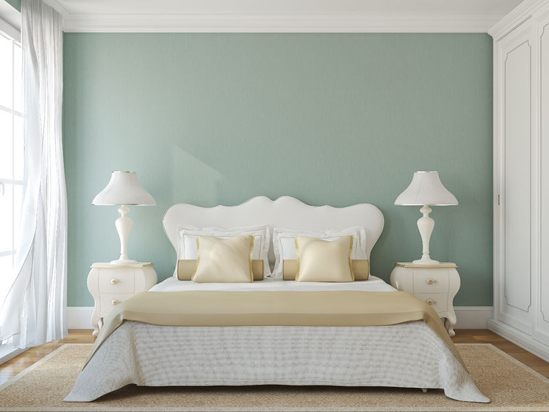 stunning big bed with white features and a light green wall