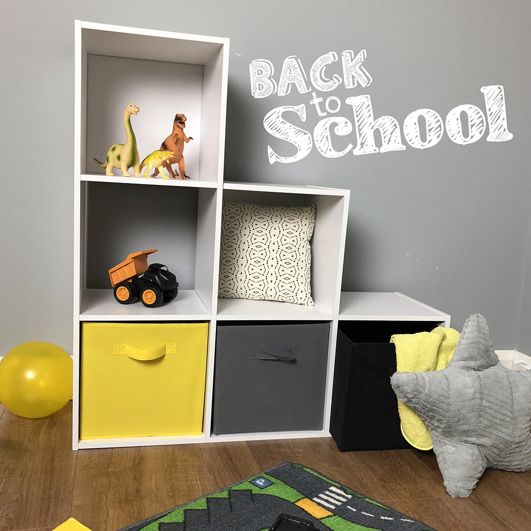 yellow black and white cube storage in a yellow themed kids bedroom